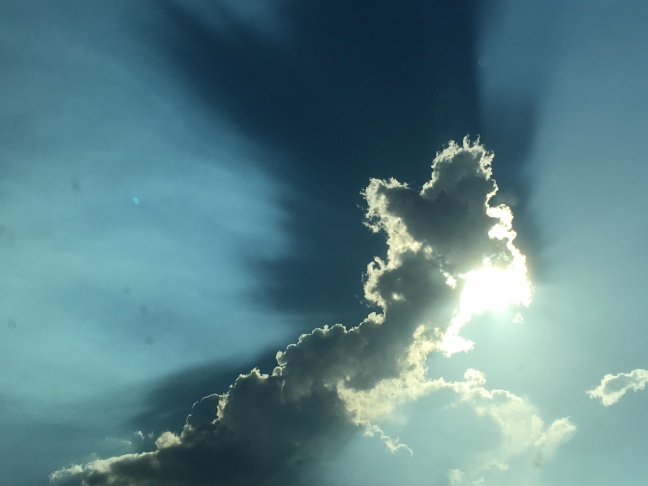 The clouds cast a shadow in the moisture-laden atmosphere.